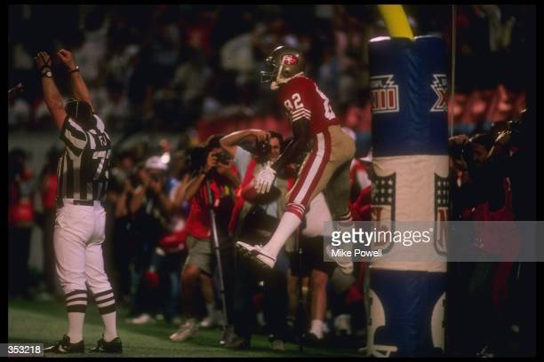 Wide receiver John Taylor of the San Francisco 49ers scores a touchdown during Super Bowl XXIII against the Cincinnati Bengals at Joe Robbie Stadium...