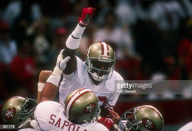 Wide receiver Jerry Rice of the San Francisco 49ers celebrates with his teammates during Super Bowl XXIV against the Denver Broncos at the Superdome...