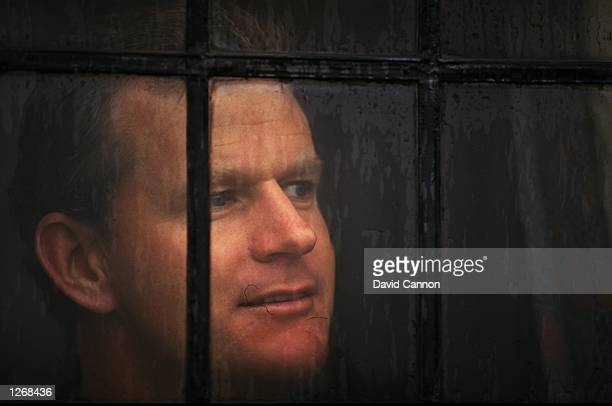 Golfer Sandy Lyle of Scotland looks out of a window Mandatory Credit David Cannon/Allsport