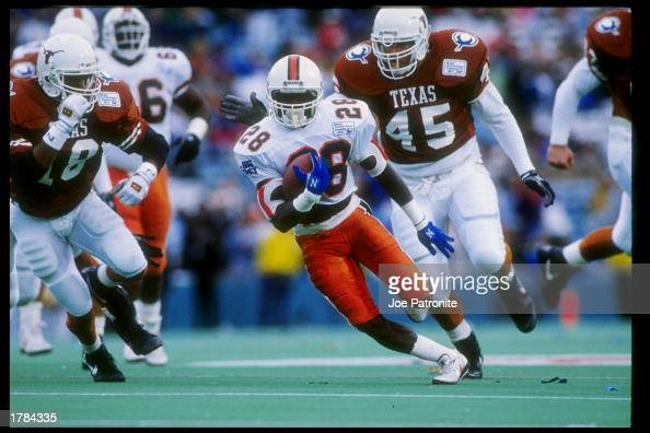 Running back Leonard Conley of the Miami Hurricanes runs down the field during the Cotton Bowl against the Texas Longhorns at the Cotton Bowl in...