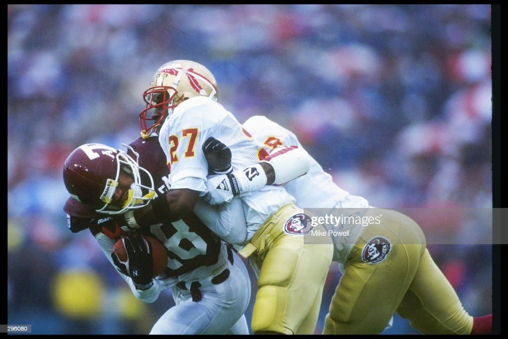 Cornerback Terrell Buckley of the Florida State Seminoles tackles Brian Mitchell of the Texas AM Aggies at the Cotton Bowl in Dallas Texas Florida...