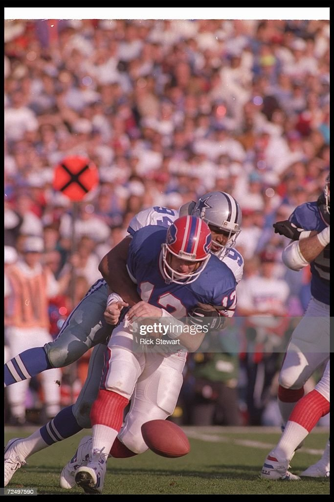 Defensive lineman <a gi-track='captionPersonalityLinkClicked' href=/galleries/search?phrase=Charles+Haley&family=editorial&specificpeople=749338 ng-click='$event.stopPropagation()'>Charles Haley</a> #94 of the Dallas Cowboys sacks Buffalo Bills quarterback <a gi-track='captionPersonalityLinkClicked' href=/galleries/search?phrase=Jim+Kelly+-+American+Football+Player&family=editorial&specificpeople=216547 ng-click='$event.stopPropagation()'>Jim Kelly</a> #12 during Super Bowl XXVII at the Rose Bowl in Pasadena, California. The Cowboys won the game, 52-17. Mandatory Credit: Rick Stewart /Alls
