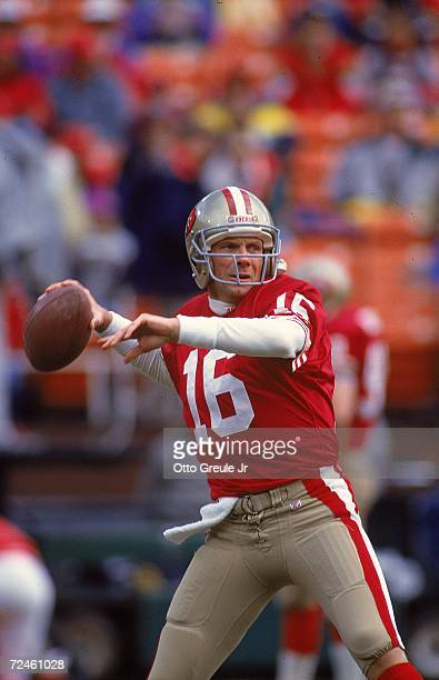 Joe Montana of the San Francisco 49ers gets ready to pass the ball during a NFC Division Playoff Game against the Washington Redskins at the RFK...