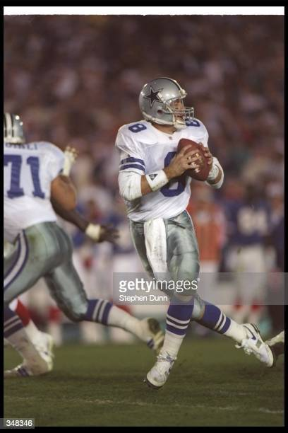 Quarterback Troy Aikman of the Dallas Cowboys fades back to pass the ball during Super Bowl XXVII against the Buffalo Bills at the Rose Bowl in...