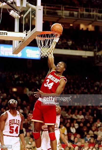 Center Hakeem Olajuwon of the Houston Rockets goes up for two during a game against the Chicago Bulls Mandatory Credit Allsport /Allsport