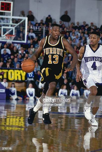 Glen Robinson of the Purdue Boilermakers dribbles the ball during a game against the Northwestern Wildcats in Saint Paul Minnesota The Boilermakers...