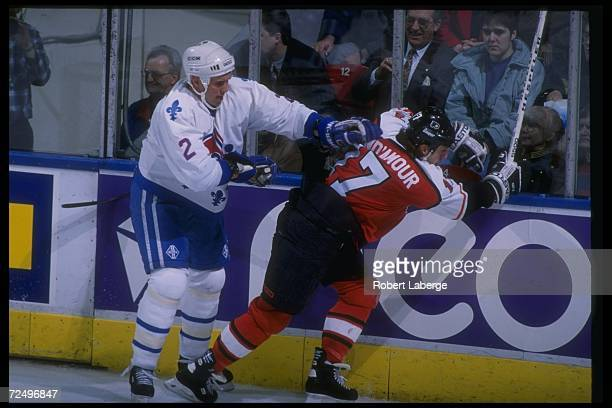 Defenseman Sylvain Lefebvre of the Quebec Nordiques and center Rod Brind'amour of the Philadelphia Flyers tangle up during a game at the Quebec...