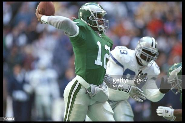 Quarterback Randall Cunningham of the Philadelphia Eagles passes the ball during a playoff game against the Dallas Cowboys at Texas Stadium in Irving...