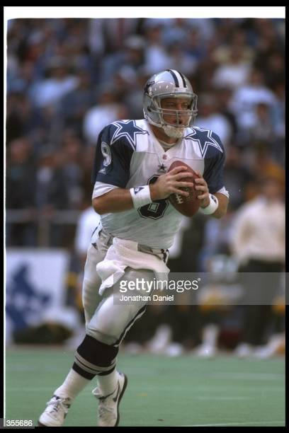 Quarterback Troy Aikman of the Dallas Cowboys looks to pass the ball during a playoff game against the Green Bay Packers at Texas Stadium in Irving...