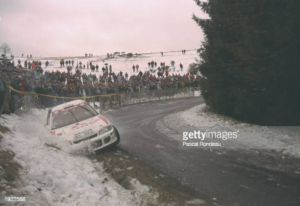 Tommi Makinen and Seppo Harjane of Finland slide off the road in their Mitsubishi Lancer during the Monte Carlo Rally in Monaco Makinen and Harjane...