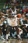 Center Shaquille O''neal of the Orlando Magic backs into Sam Perkins of the Seattle Supersonics during the Magic 11593 win over the Seattle...