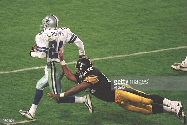 Cornerback Larry Brown of the Dallas Cowboys is knocked out of bounds by running back John L Williams of the Pittsburgh Steelers during the 4th...