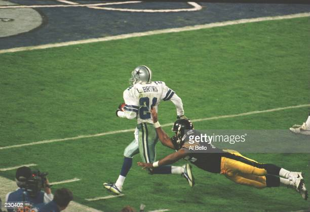 Cornerback Larry Brown of the Dallas Cowboys is pushed out of bounds by running back John L Williams of the Pittsburgh Steelers during the 4th...