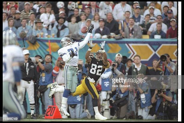 Defensive back Deion Sanders of the Dallas Cowboys breaks up a pass intended for Pittsburgh Steelers wide receiver Yancey Thigpen during Super Bowl...