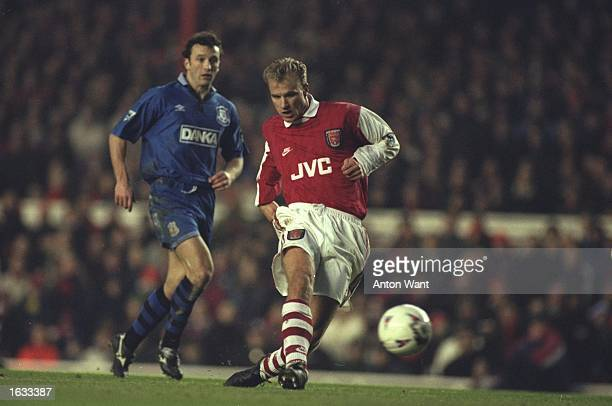 Dennis Bergkamp of Arsenal gets away from Barry Horne of Everton during an FA Carling Premiership match at Highbury Stadium in London Everton won the...