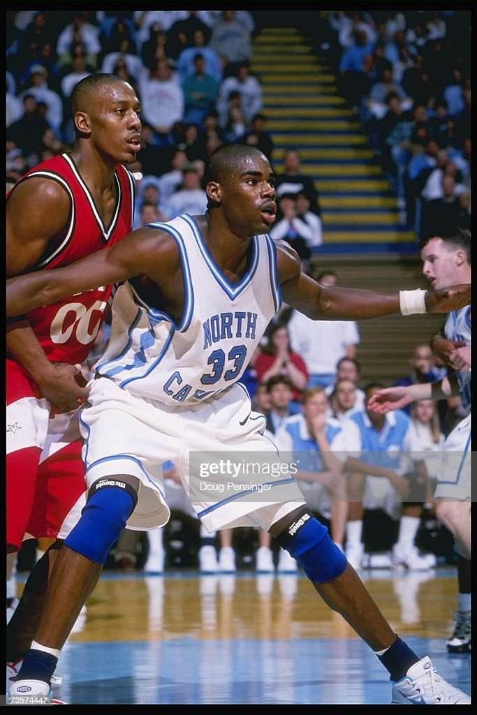 Forward Anton Jamison of the UNC Tar Heels and forward Danny Strong of the North Carolina State Wolfpack look for the ball during a game held at the...