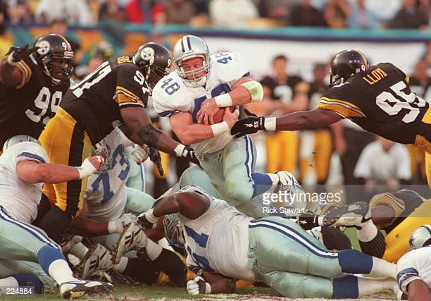 Fullback Daryl Johnston of the Dallas Cowboys bursts through the Pittsburgh Steelers defensive line for a fouryard gain on 4th down during the second...