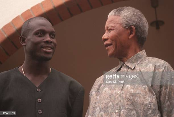 George Weah of Liberia meets South African President Nelson Mandela at Mandela's house in Houghton South Africa Mandatory Credit Gary Prior/ALLSPORT