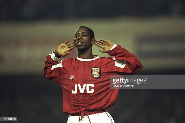 Ian Wright of Arsenal holds his hands to his ears during the Coca Cola Cup quarterfinal against Newcastle at Highbury Stadium in London Arsenal won...