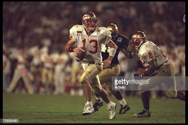 Quarterback Danny Kanell of the Florida State Seminoles is chased out of the pocket by a Notre Dame Fighting Irish defender during the Orange Bowl in...