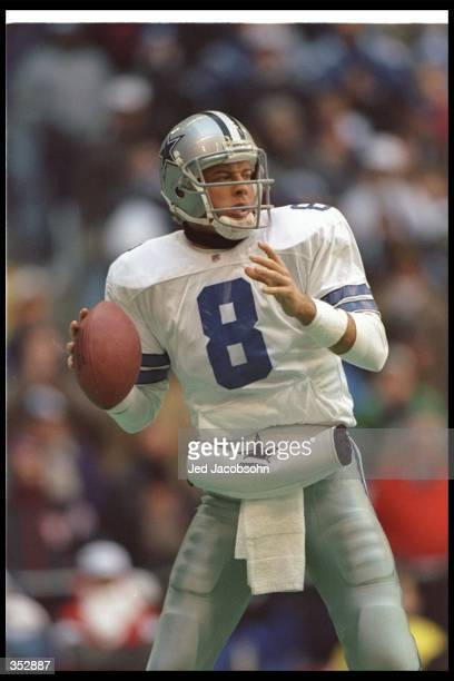 Quarterback Troy Aikman of the Dallas Cowboys looks to pass the ball during a playoff game against the Philadelphia Eagles at Texas Stadium in Irving...