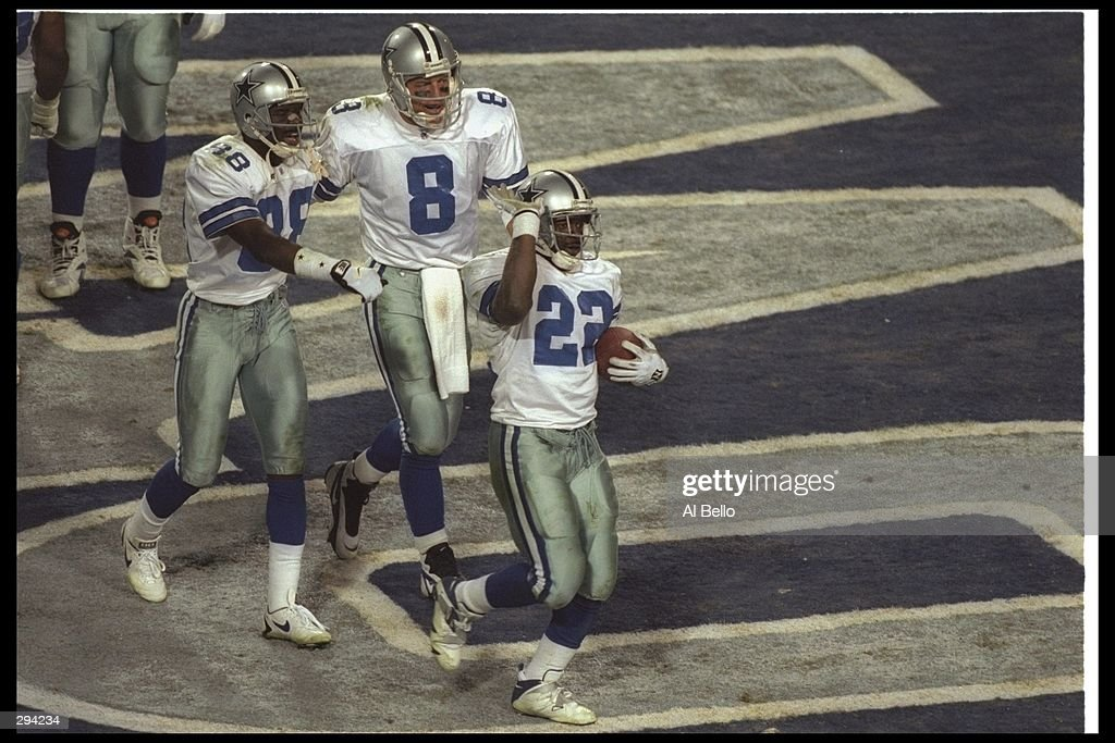 Running back Emmitt Smith of the Dallas Cowboys celebrates with teammates <a gi-track='captionPersonalityLinkClicked' href=/galleries/search?phrase=Michael+Irvin&family=editorial&specificpeople=218074 ng-click='$event.stopPropagation()'>Michael Irvin</a> #88 and <a gi-track='captionPersonalityLinkClicked' href=/galleries/search?phrase=Troy+Aikman&family=editorial&specificpeople=206871 ng-click='$event.stopPropagation()'>Troy Aikman</a> #8 after Smith scored a touchdown against the Pittsburgh Steelers at Super Bowl XXX at Sun Devil Stadium in Tempe, Arizona. The Cowboys won the game 27 - 17. Mandatory Credi