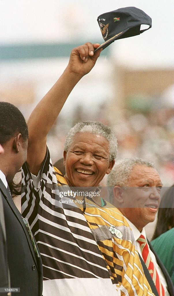 South Africa president Nelson Mandela salutes the crowd before the opening game of the African Cup of Nations in Johanassberg South Africa Mandatory...