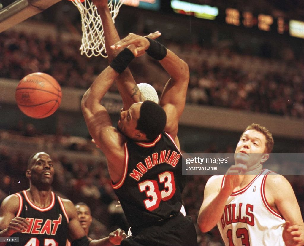 The ball sails out of reach from the grasp of Center Alonzo