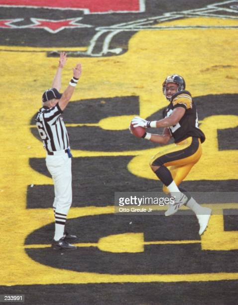 Wide receiver Yancey Thigpen of the Pittsburgh Steelers jumps in the air in celebration after scoring a touchdown during the second quarter of the...