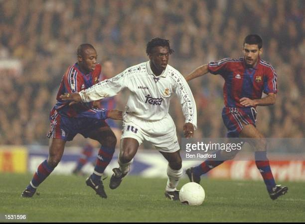 Amunike of Barcelona Clarence Seedorf of Real and Guardiola of Barcelona challenge for the ball During the Spanish cup match between Barcelona and...