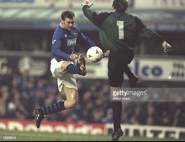 Duncan Ferguson of Everton tries to chips the ball past Fraser Digby the Swindon goalkeeper during the FA Cup third round tie at Goodison Park in...