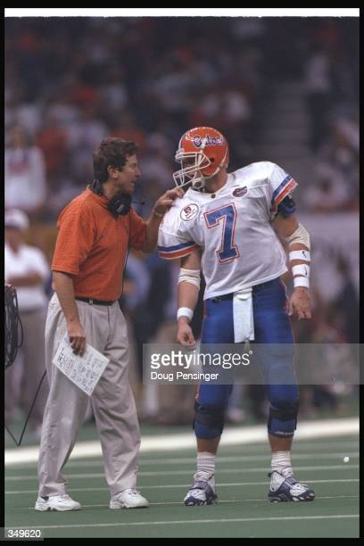 Florida Gators head coach Steve Spurrier confers with quarterback Danny Wuerffel during the Nokia Sugar Bowl against the Florida State Seminoles at...