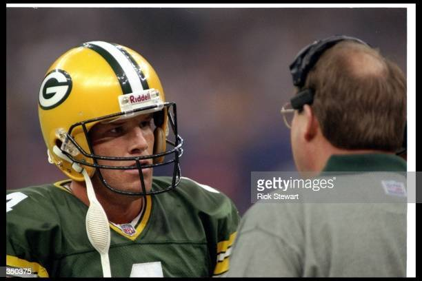Green Bay Packers head coach Mike Holmgren and quarterback Brett Favre confer during Super Bowl XXXI against the New England Patriots at the...