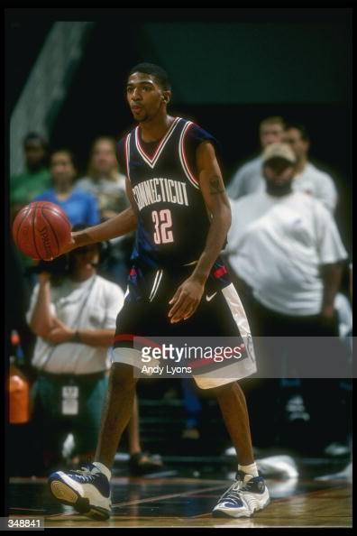Guard Richard Hamilton of the Connecticut Huskies moves the ball during a game against the Miami Hurricanes at the Miami Arena in Miami Florida Miami...