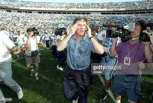 North Carolina Tar Heels head coach Mack Brown looks on during the Gator Bowl against the West Virginia Mountaineers at Jacksonville Stadium in...
