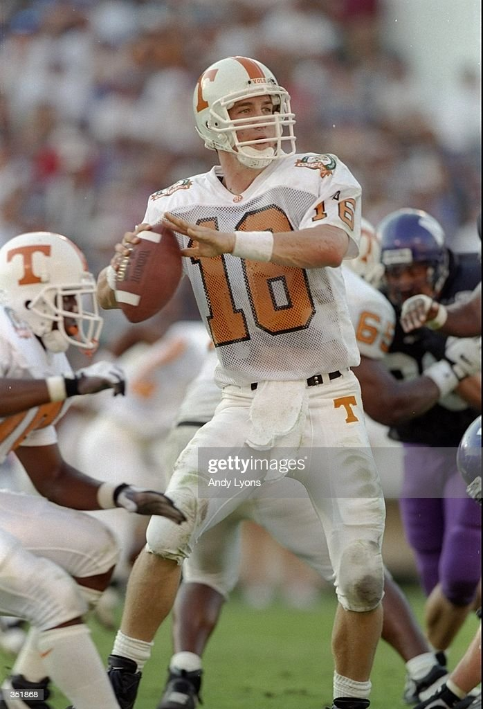 Quarterback Peyton Manning of the Tennessee Volunteers looks to pass the ball during the Citrus Bowl against the Northwestern Wildcats at the Citrus...