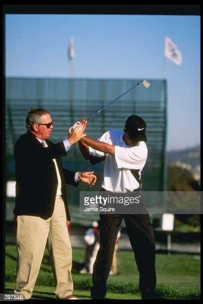 Tiger Woods gets some lesssons from Butch Harmon at the Mercedes Championships at La Costa Resort Spa in Carlsbad California