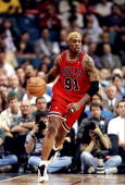 Forward Dennis Rodman of the Chicago Bulls moves the ball during a game against the Miami Heat at the Miami Arena in Miami Florida The Heat won the...