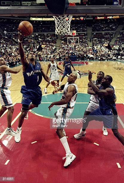 Guard Rod Strickland of the Washington Wizards goes up for two during a game against the Detroit Pistons at The Palace in Detroit Michigan The...