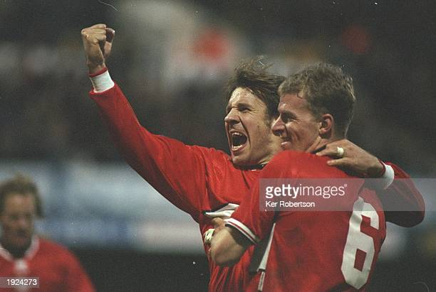 Robbie Mustoe and Paul Merson of Middlesbrough celebrate a goal during the FA Cup round three tie against Queens Park Rangers at Loftus Road in...