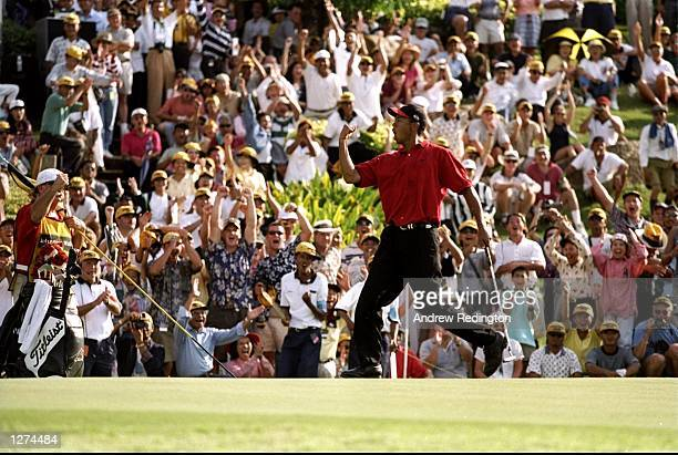 Tiger Woods of the USA celebrates victory in the Johnnie Walker Classic at the Blue Canyon Golf Club in Phuket Thailand Mandatory Credit Andrew...