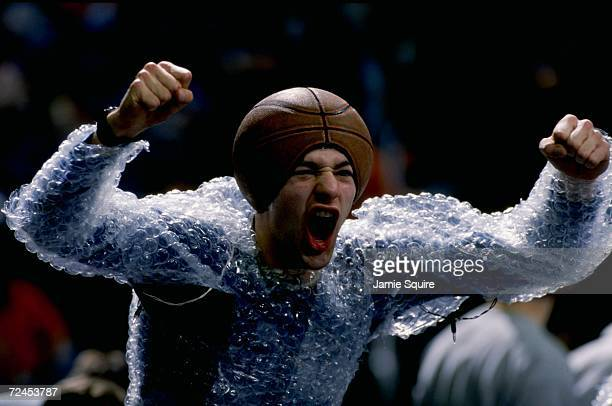 A fan of the Georgetown Hoyas dresses in bubble wrap and a basketball hat during the game against the Syracuse Orangemen at the MCI Center in...