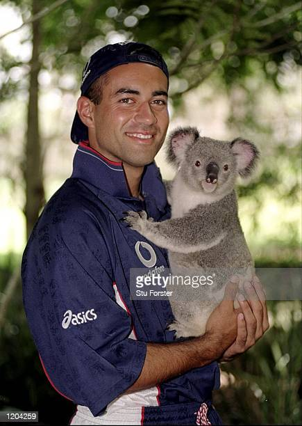 Adam Hollioake of England holds a Koala bear during the Carlton United 1 Day Series in Sydney Australia Mandatory Credit Stu Forster /Allsport