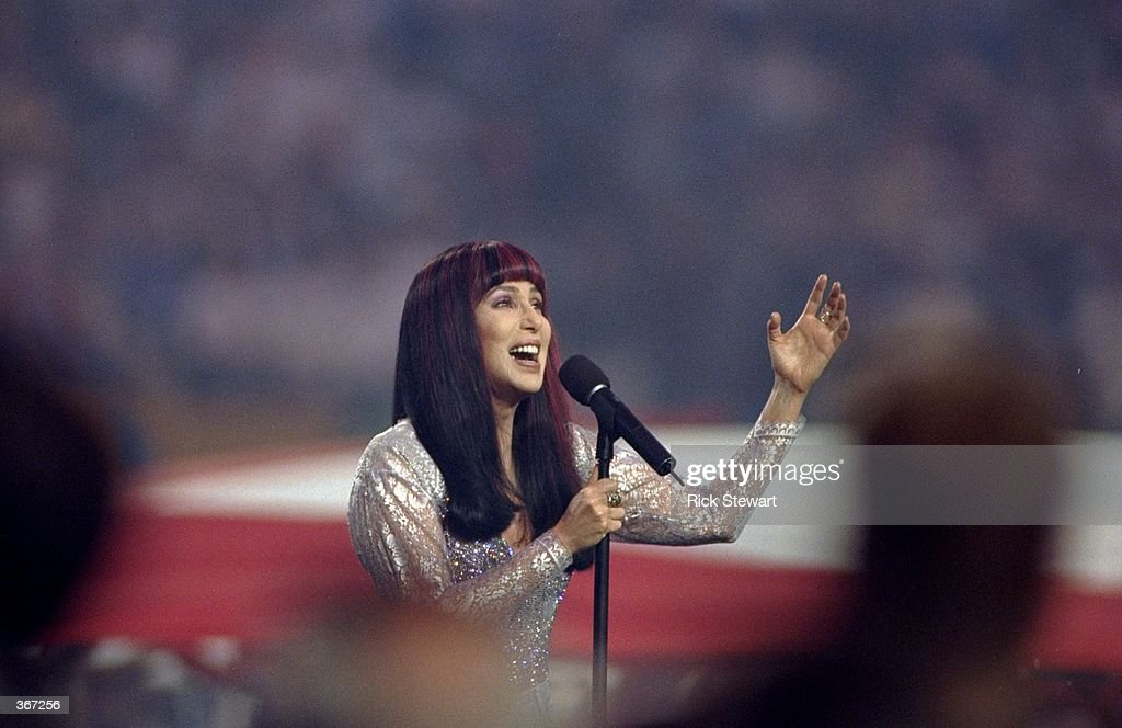 Cher sings the National Anthem during the pregame show for Super Bowl XXXIII between the Atlanta Falcons and the Denver Broncos at Pro Player Stadium...