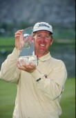David Duval poses with the winners trophy during the Bob Hope Chrysler Classic at the PGA West Palmer Country Club in La Quinta California Mandatory...