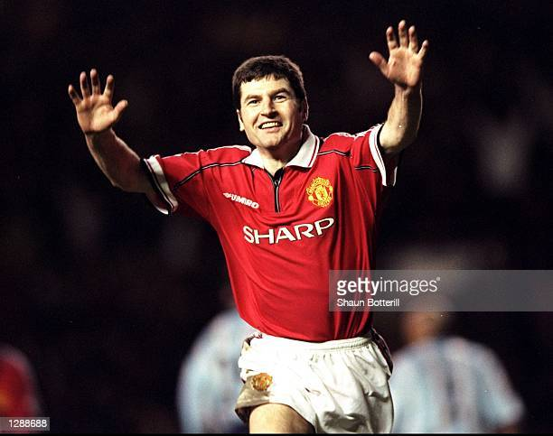 Denis Irwin of Manchester United celebrates his goal against Middlesbrough in the FA Cup third round match at Old Trafford in Manchester England...