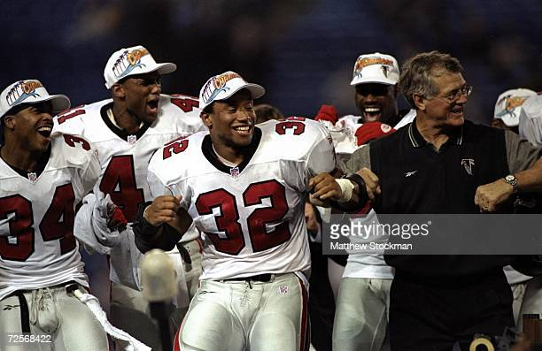 Jamal Anderson of the Atlanta Falcons dances the dirty bird with coach Dan Reeves during the NFC Championship Game against the Minnesota Vikings at...