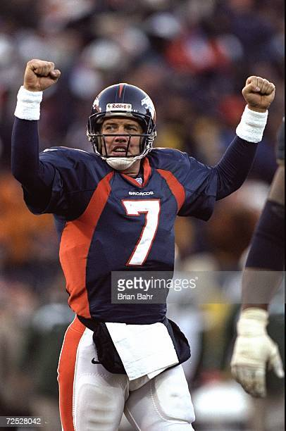 John Elway of the Denver Broncos celebrates during the AFC Championship Game against the New York Jets at Mile High Stadium in Denver Colorado The...