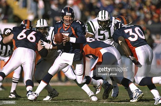 John Elway of the Denver Broncos looks to throw during the AFC Championship Game against the New York Jets at Mile High Stadium in Denver Colorado...