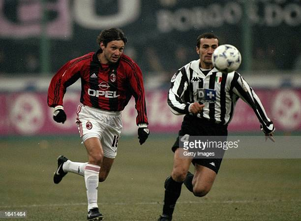 Leonardo of AC Milan chases Paulo Montero of Juventus during the Italian Serie A match at the San Siro in Milan Italy The game ended in a 11 draw...